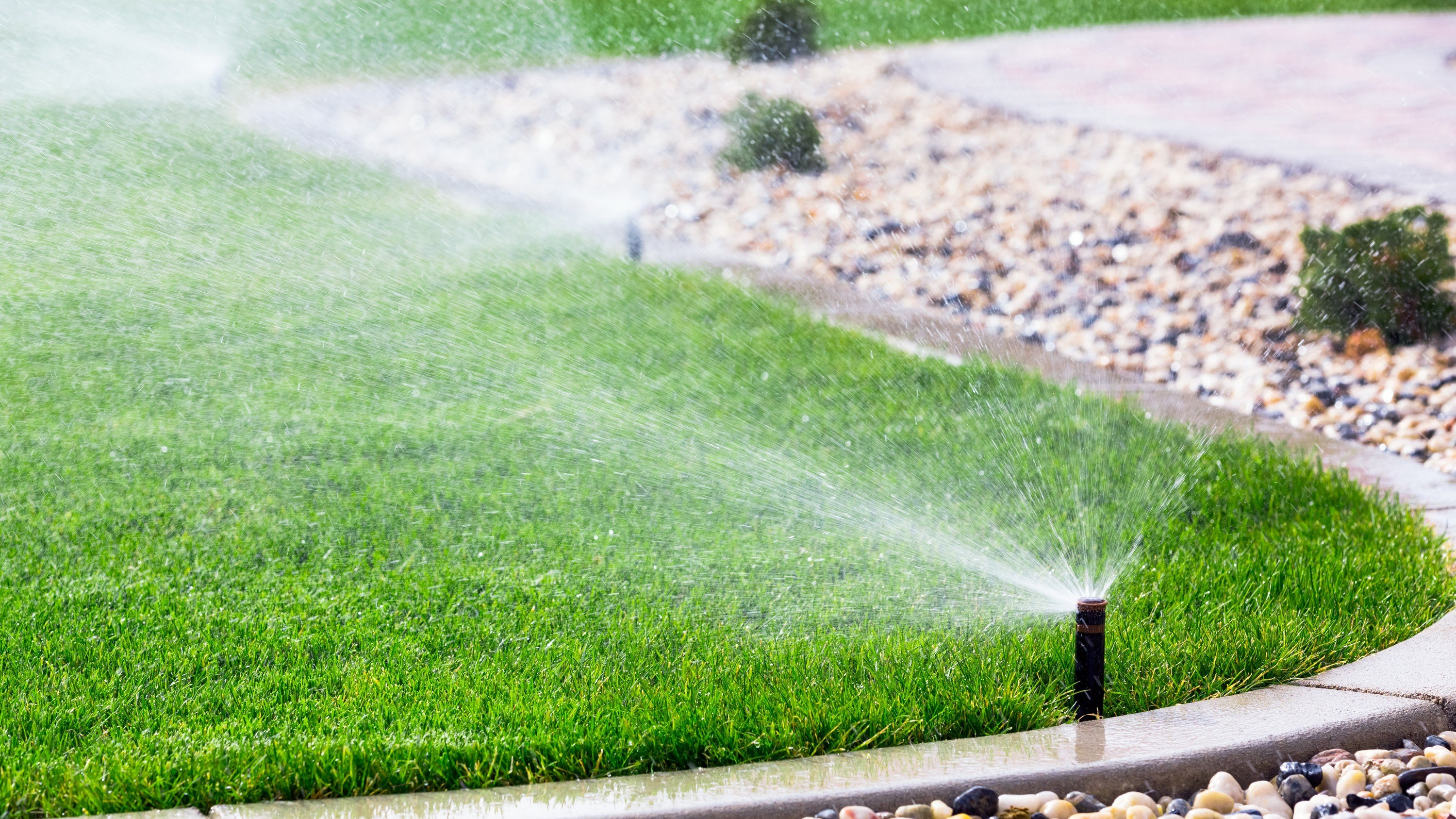 photodune-7155588-sprinklers-watering-grass-l-e1430526220145